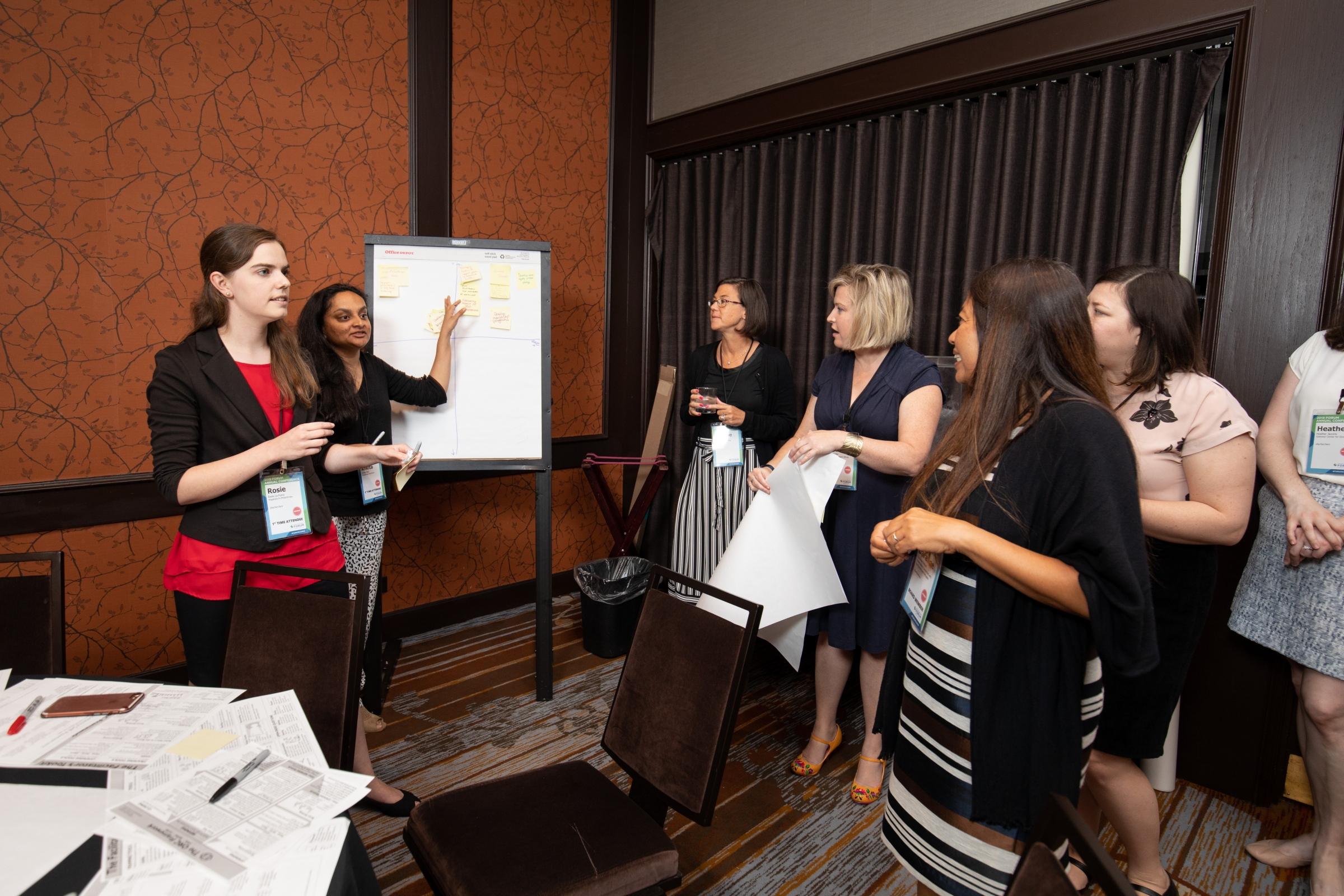 ForumCon19 attendees engaging in activity.
