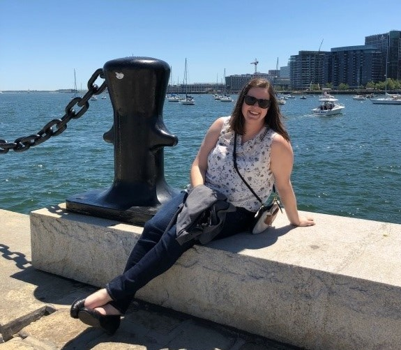 Here is a picture of me putting the first commitment into practice – relaxing by the Boston waterfront after conference sessions!