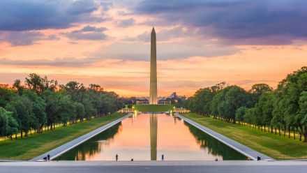 Washington Monument and reflecting pool with sunset in the background