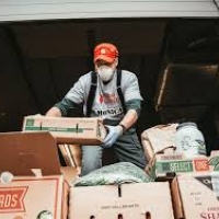 Worker moving food