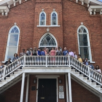 The group outside of the Dexter Avenue King Memorial Baptist Church in Montgomery, AL, which served as the backbone of the Montgomery Bus Boycott and is where Rev. Dr. Martin Luther King, Jr. began his career.